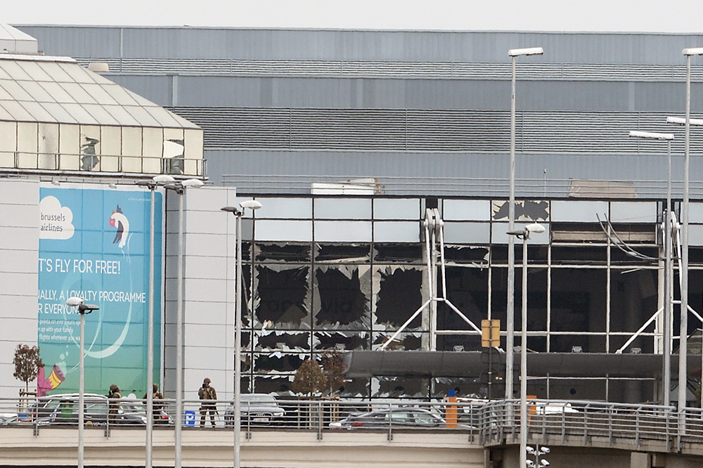 Broken windows at the airport after the attacks. Dirk Waem/AFP/Getty Images