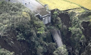 Houses are seen in a landslide hit area in Minamiaso Photograph: AP