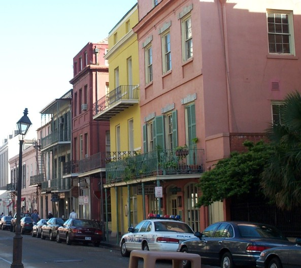 Colorful homes in New Orleans, 2001, from Conti Street, looking riverwards from Royal Street. Entrance to Exchange Alley is just past the yellow building. - Photo CC by Photo by justinsomnia.org