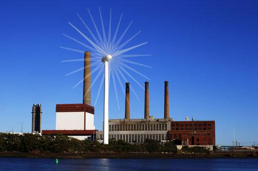 Une éolienne devant une centrale fonctionnant aux energies fossiles (Massachusetts, Etats-Unis• Crédits : Brian Snyder - Reuters
