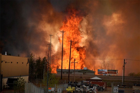 Flames rise in Industrial area south Fort McMurray, Alberta Canada May 3, 2016. (CBC News/REUTERS)